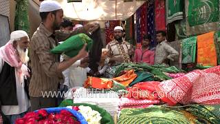 Colourful holy chaddars being sold near Ajmer Sharif Dargah in Rajasthan