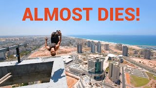 Guy Backflips on the Top of a Skyscraper Platform | ALMOST DIES