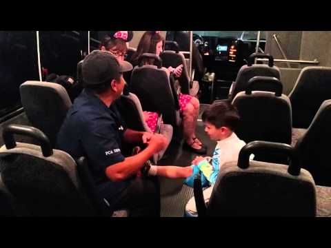 Bus driver gives child a foot massage