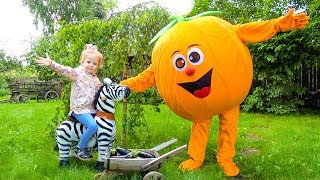 Giant fruit toys and funny kid playing in the garden Video for children