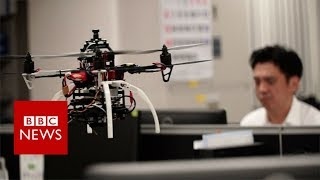 Using drones to battle overwork in the office - BBC News