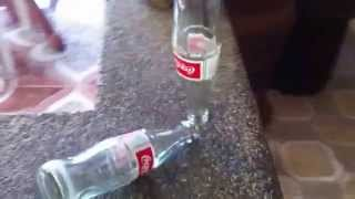 Coke bottle balancing act