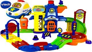 UNBOXING VTECH GO GO SMART WHEELS POLICE STATION PLAYSET WITH POLICE CAR JAIL TRAFFIC CIRCLE & SONGS