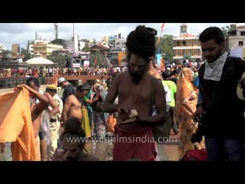 Sadhus rub ash after bathing - Kumbh Mela