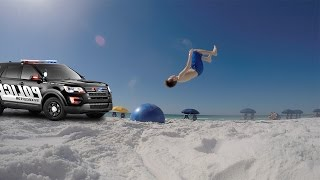 THIS WAS SO SKETCHY! *POLICE COME* ATTEMPTING INSANE FLIPS AT THE BEACH OFF A YOGA BALL!