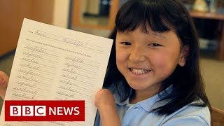 The girl with stellar handwriting - but no hands - BBC News