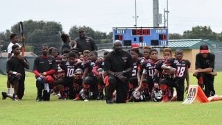 Youth football team abandoned after national anthem protest