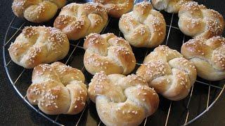 Crispy buns with sesame seeds. Delicious homemade scones. Recipe dough.