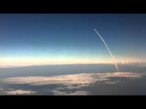 Space Shuttle Launch Viewed From an Airplane