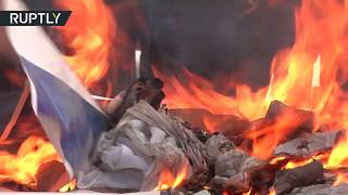Protesters at Gaza border burn Israeli flags