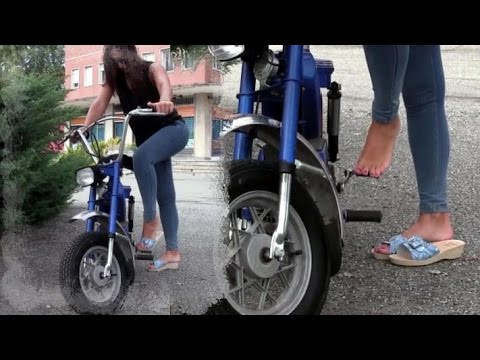 Miss Iris cranks and revs the moped Garelli Trailer Pedal Pumping