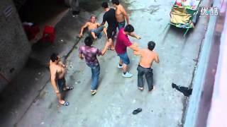Shirtless men fight in Guangzhou, China