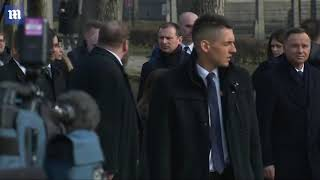 Mike Pence visits Auschwitz memorial site during Poland trip