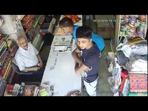 Robbery by indian teen boys recorded in camera. Theft video in india.
