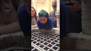 A school girl sings Hallelujah into A Well in Italy like an angel