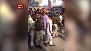 MP CM Shivraj Singh Chauhan slaps a man during a road show in Sardarpur