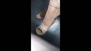 P-love's office tootsies dangle in fishnet socks