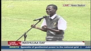 Juma Idi Juma recites a poem at Masujaa Day celebrations