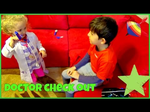 Cute little girl playing Doc Mcstufffins / kids playing doctor