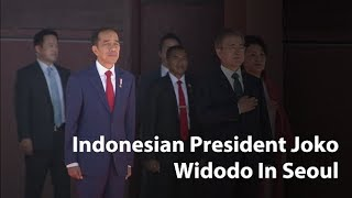Indonesian President Joko Widodo gets a tour of Changdeok Palace in Seoul