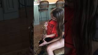 2016 Giavanna Gast teaching baby brother sax.