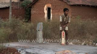 Little kids play cricket in rural South India