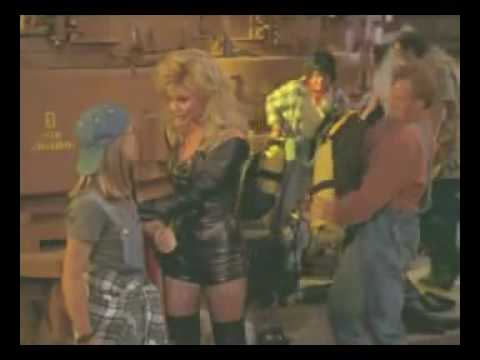 Sexy Loni Anderson in leather top shorts boots and gloves