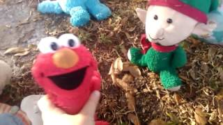 Elmo And Friends are Playing on the slide at The Play Ground