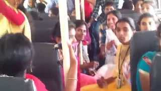 COLLEGE STUDENTS SINGING AND ENJOYING IN COLLEGE BUS