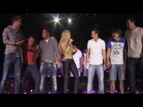 Barcelona players on stage with Shakira (Suerte)
