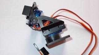Assembling a pan tilt camera mounting module