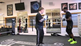 Ricky Hatton on the pads with Nigel Benn