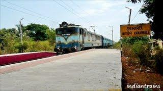 indiantrains@ superfast train action at karambele station near vapi/valsad gujarat, india
