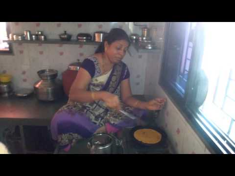 Aunty seating on Kitchen Plateform and making Thepla for all of us on Makar Sankranti Jan 2016 2