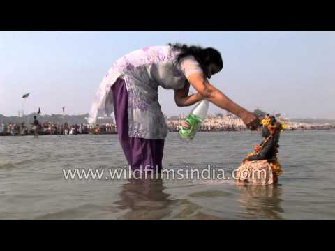 Xxx Mp4 Woman In Salwar Kameez Suit Prays To Statue In Ganges River 3gp Sex