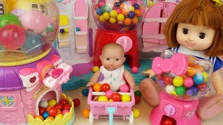 Candy dispenser and Baby doll surprise eggs mart toys play