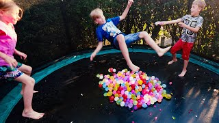 Water Balloons Splash Fun on Trampoline for Kids in Slow Motion