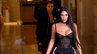 Kim Kardashian, Kanye West and Kourtney Kardashian come out of the Givenchy showroom in Paris