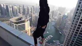 insane handstand on high rise building