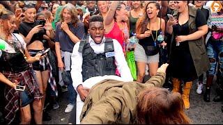 Police Officer Daggering Girls At Notting Hill Carnival