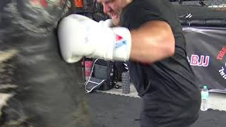 Brad Riddell and Coach Woody conditioning bag workout