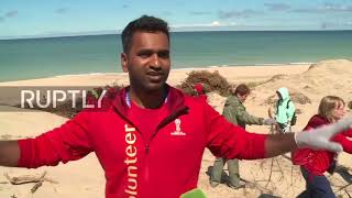 Russia: Intl. World Cup volunteers help clean up the Curonian Spit
