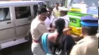 Tamilnadu Police Beating a lady in public