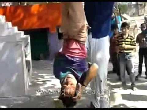 Graphic and disturbing : Boy hung upside down, beaten with stick as punishment