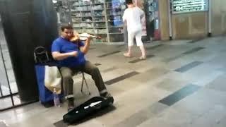 Vivaldi four seasons played in subway by street musician