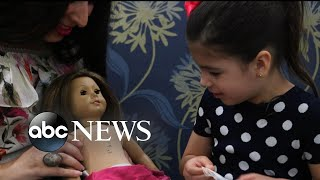 Little girl and her American Girl doll have matching surgery scars