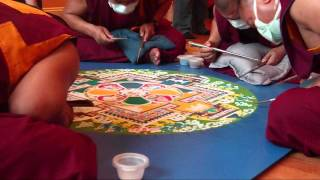 Monks from Drepung Gomang making a sand Mandala at Sun Dog Yoga in Doylestown, PA