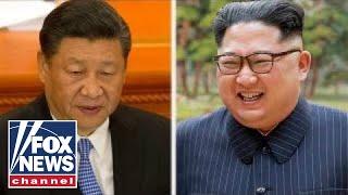 China pressures North Korea to hold summit