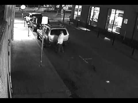 Guy urinating on the car