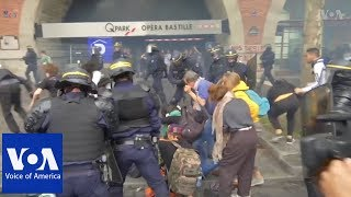 Police use teargas and batons to suppress demonstrators in Paris, France